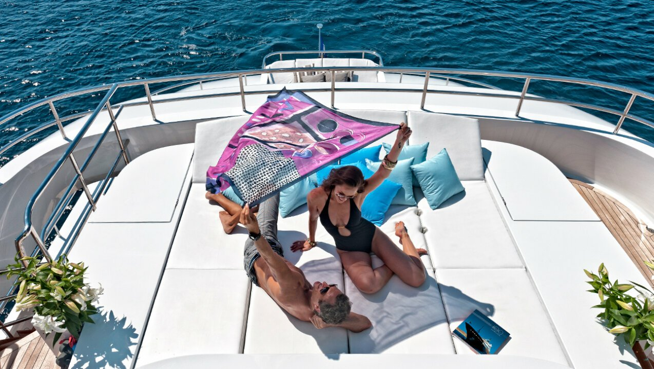 couple relaxing on deck in Italy