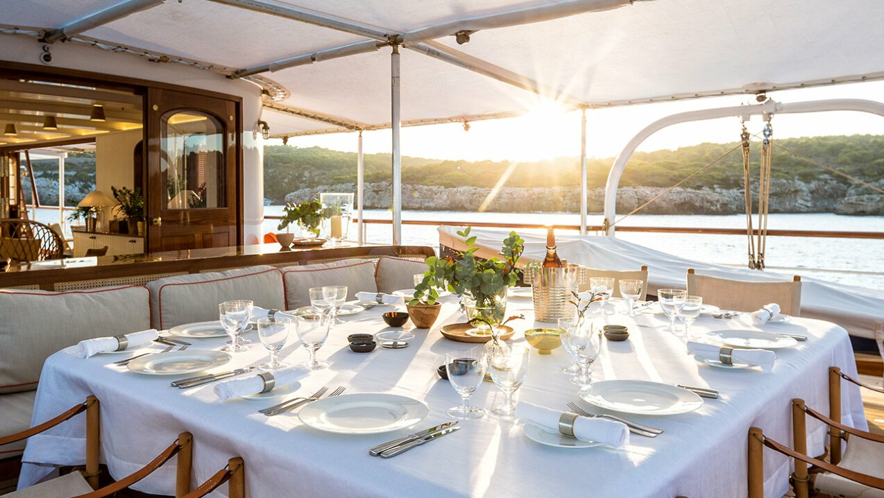 Dinner on deck at sunset in Corsica