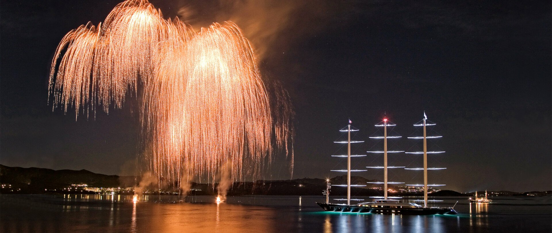 Fireworks in Sardinia port with Maltese Falcon