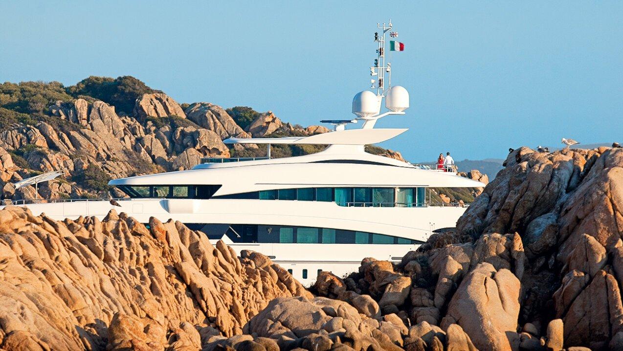 Yacht next to a island in Sardinia