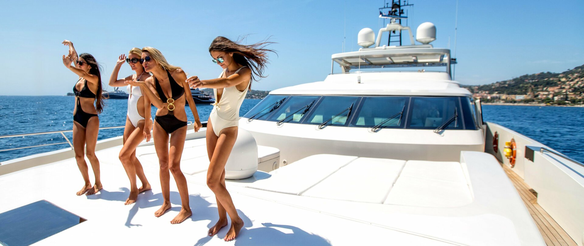 charter guests dancing on a yacht in Ibiza
