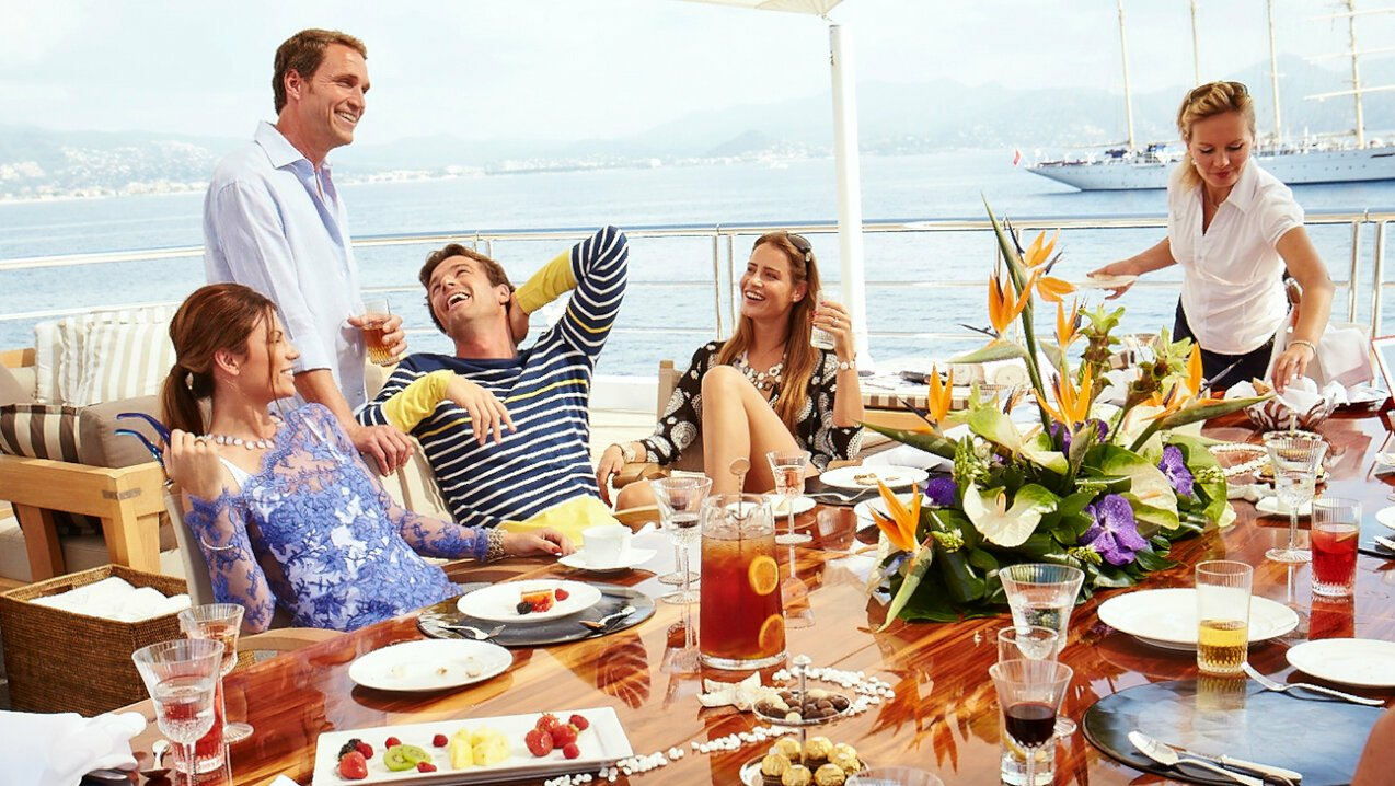 Charter guests dining on deck in the Côte d'Azur