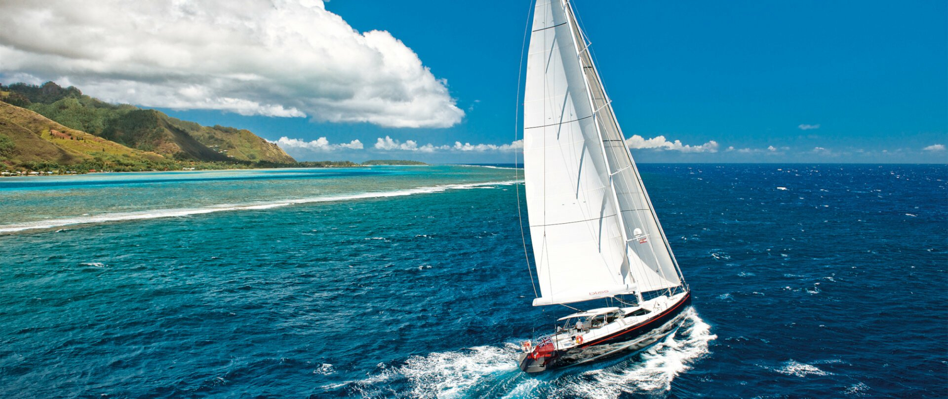 Sailing yacht passing by islands in the Seychelles
