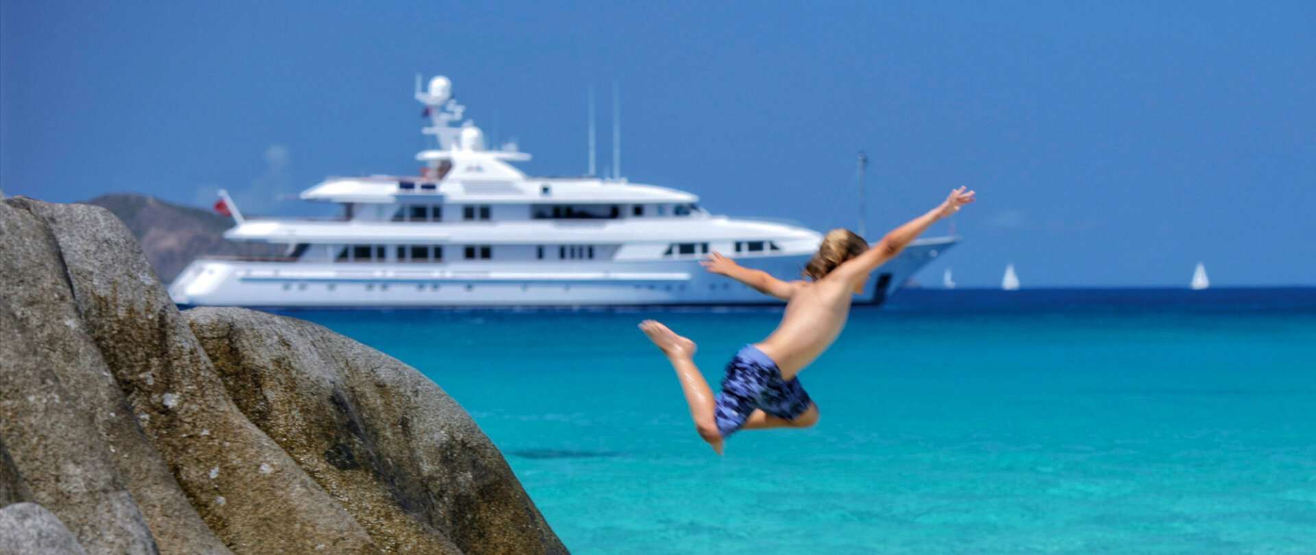 Diving from rocks near your yacht in the Maldives