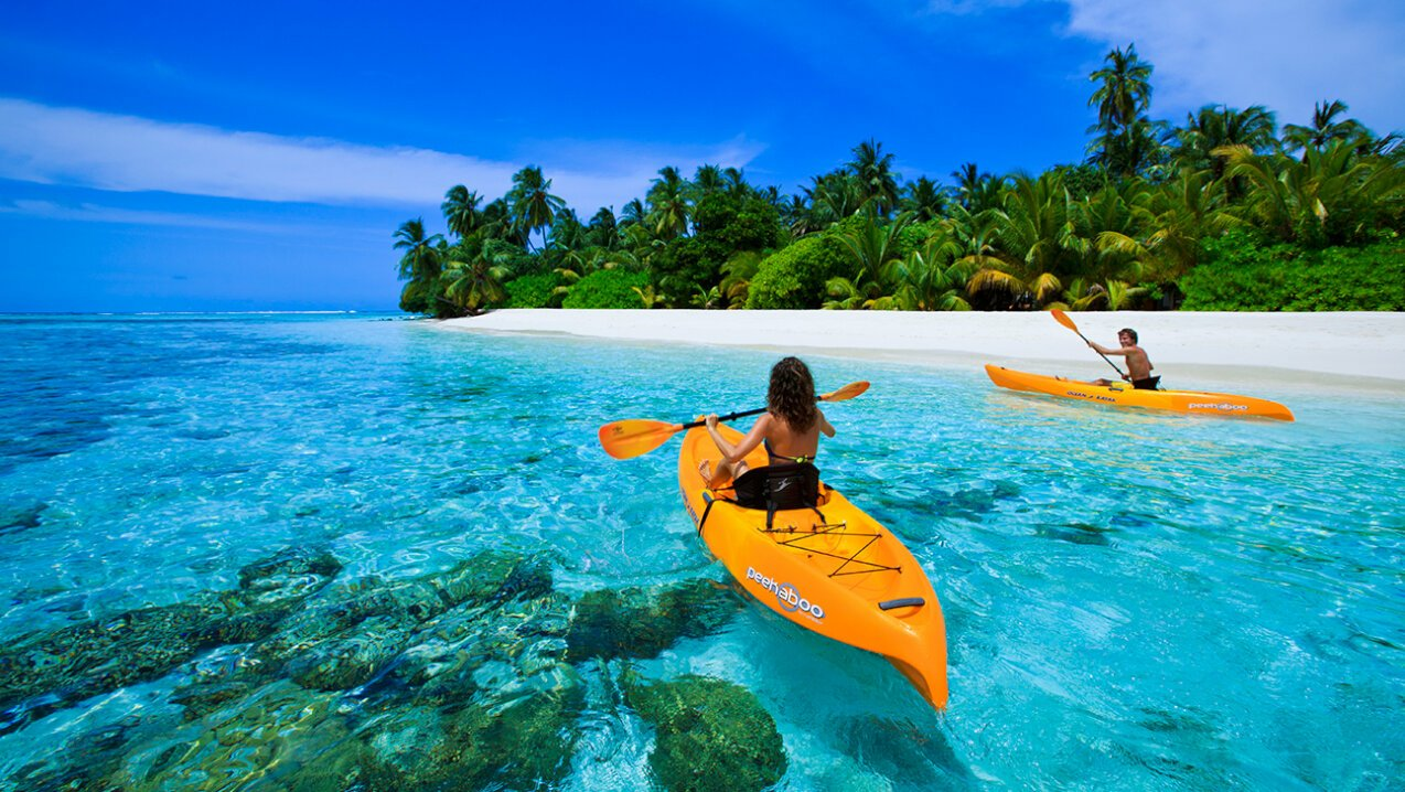 Kayaking in the shallows of an island in the Maldives