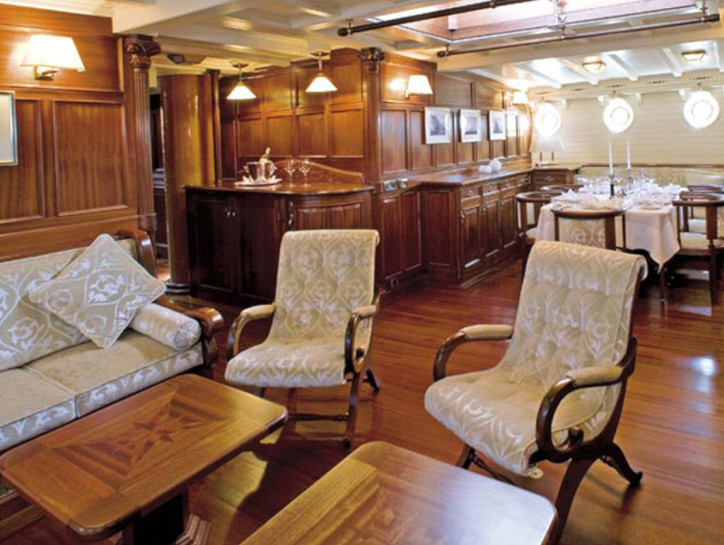 Eleonora Living space in the Eleonora yacht, with luxury wooden floors, walls and table