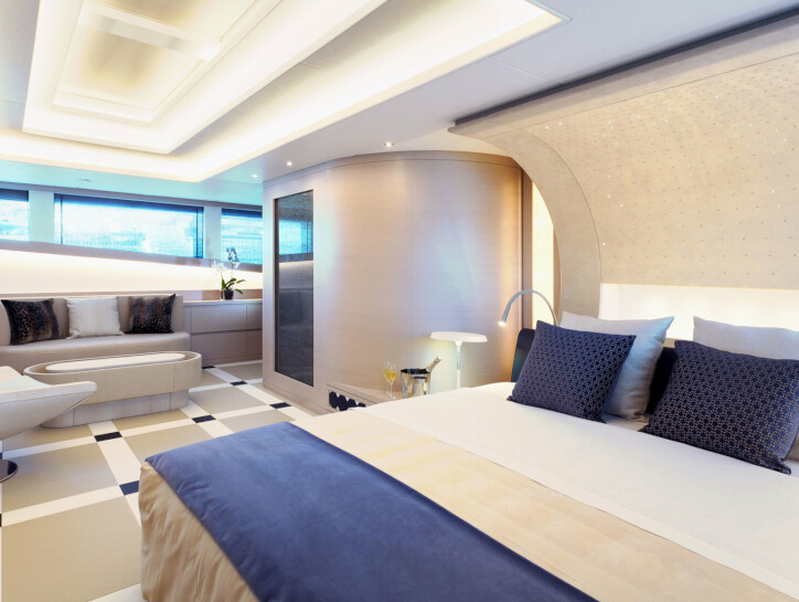 Philmi A luxurious bedroom with king sized bed, inside the Philmi Yacht and decorated with blue and grey cushions