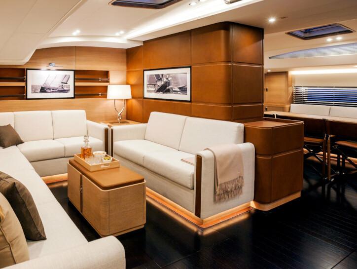 Shamanna The inside living area on the Shamanna yacht, with black wooden floor, cream sofas and cushion decorations