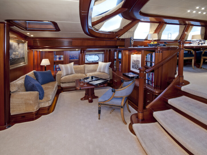 Hyperion The mezzanine within the Hyperion yacht, with carpeted floor and stairs, and wooden walls